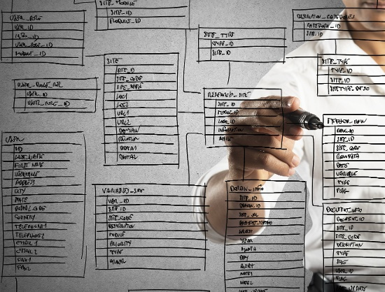 Man sketching out unique database architecture