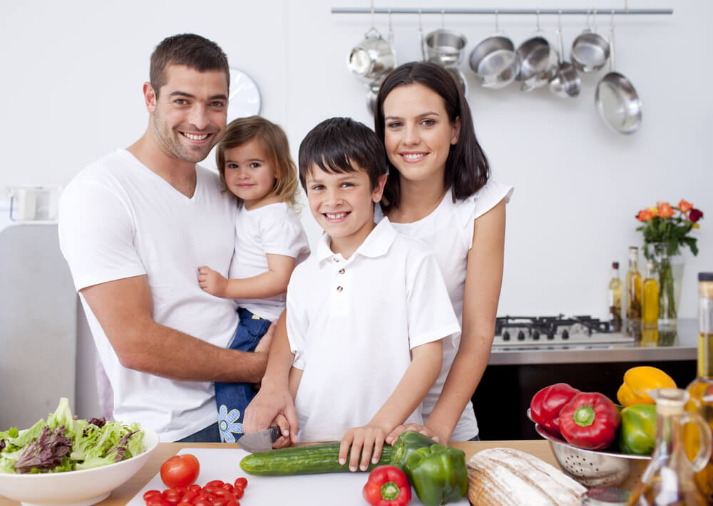 Smiling family cooking together in the kitchen (1)